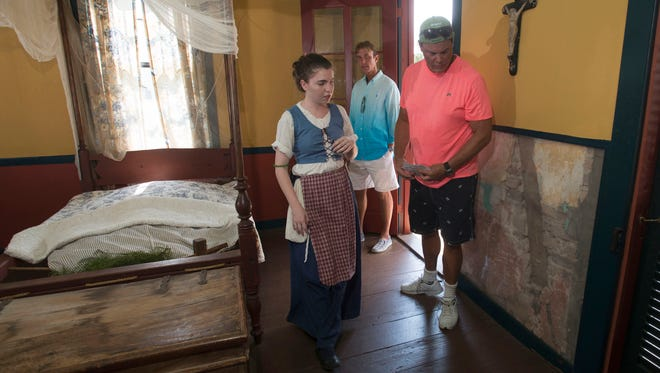 Tour Guide, Maggie Crain, left, gives a tour of the historic Lavalle House in the Historic Pensacola Village to Roy Vogel, center, and Alex Riddick, right, who are visiting the area from Atlanta, Ga.  Tuesday afternoon May 31, 2016.