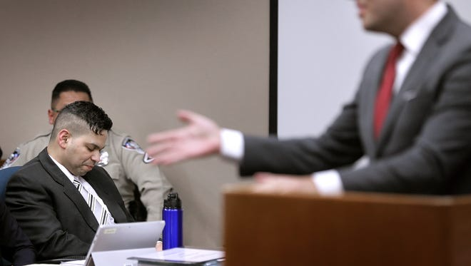 Prosecutor James Montoya gestures toward Steven Enrique Quintero Rios during the sentencing phase of Rios' murder trial Thursday in the 384th District Court, with Judge Patrick Garcia presiding. Rios was convicted of murdering his wife, Blanca Rivera.