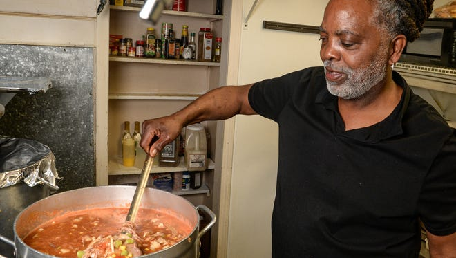 Melvin Mattison stirs Brunswick stew at Grits n' Gravy restaurant in the clubhouse of Cobbs Glen Country Club in Anderson. Mattison and his son Stormy are opening a second eatery, Wingin It.