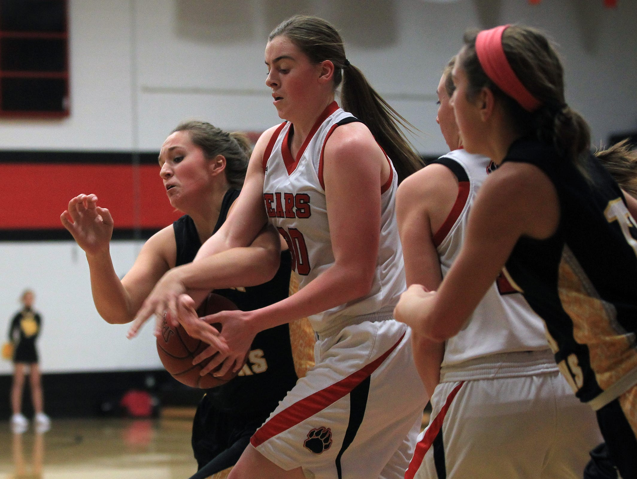 Mid-Prairie's Chelsea Bowlin fights for the ball with West Branch's Haley Poula during their game in West Branch on Tuesday, Dec. 9, 2014.