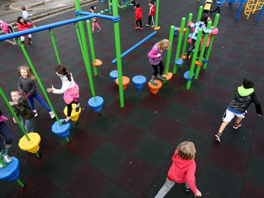Children play during recess at Grant Elementary School