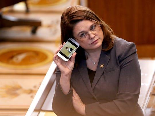 Sen. Sara Gelser listens to a live stream as members