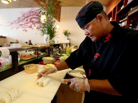 Sushi Chef Simon Wasuwo prepares a sushi roll at Momiji on Commericial Street SE in Salem.