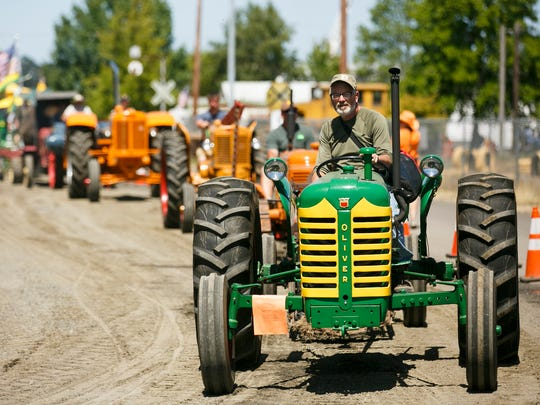 Antique tractors line up for the Parade of Power at the 46th annual Great Oregon Steam-Up on Sunday, July 31, 2016, at Antique Powerland. The Steam-Up will also be open on August 6 and 7.