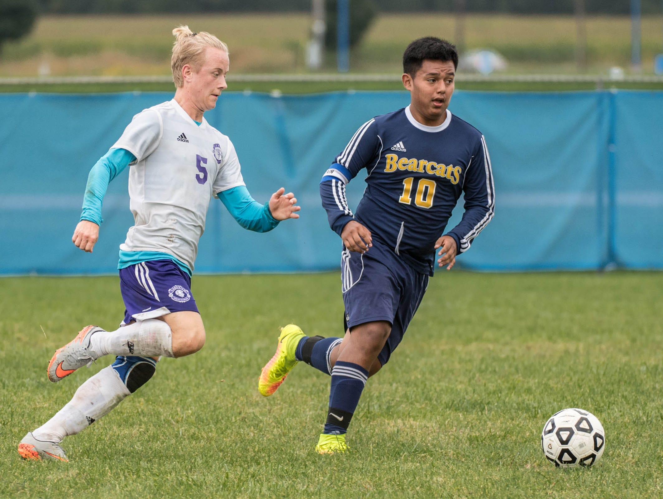 Lakeview's Theodor Pleiff (5) and Battle Creek Central's Jesus Bautista (10) go for the ball during the All City Soccer Championship on Saturday.