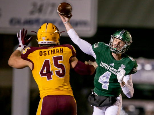 Eastern Michigan Eagles quarterback #4 Brogan Roback throws the ball against Central Michigan Chippewas.