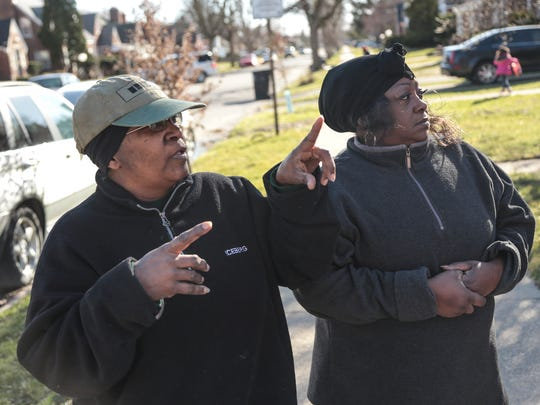 Ann Westbrook (right), of Detroit and Marion Thomas, of Detroit, talk about the fire near their homes as Detroit Fire Fighters and investigators remain on scene of a fire the occurred at an apartment complex at the corner of Whittier and Beaconsfield in Detroit's east side on Wednesday March 8, 2017.