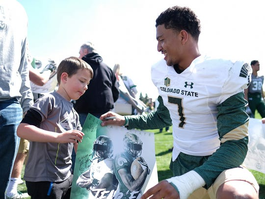 Safety Jamal Hicks, shown signing an autograph for a young fan after the April 22 spring game, played a key role defensively for CSU late last season.