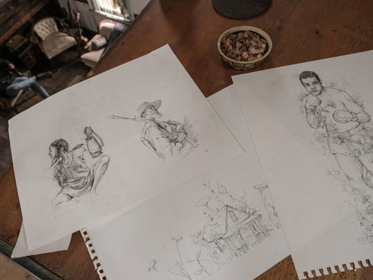 Rough sketches for murals made by Detroit artist Pat