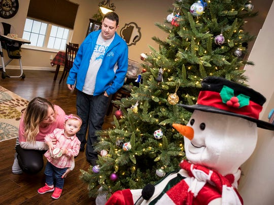 Blake and Jennifer Stringer decorate their Christmas tree with their daughter, Blakelynn,  Wednesday, Nov. 15, 2017. Blake was born with Alport Syndrome, and, in October, Jennifer donated her kidney to him.