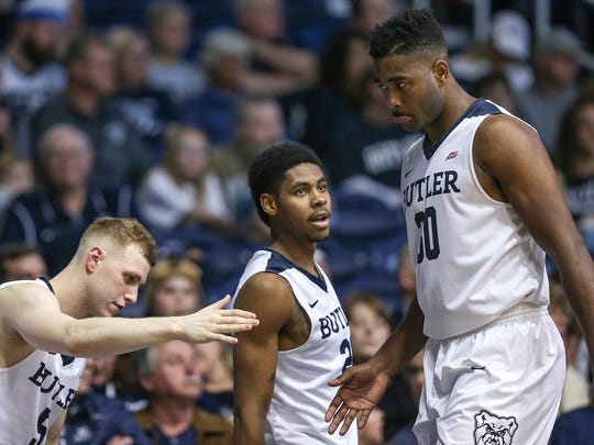 Butler Bulldogs guard Paul Jorgensen (5) and Butler Bulldogs guard Henry Baddley (20) congratulate Butler Bulldogs forward Kelan Martin (30) as he leaves the game to rest during late second half action between the Butler Bulldogs and the Saint Louis Billikens at Hinkle Fieldhouse, Indianapolis, Saturday, Dec. 2, 2017. Butler crushed Saint Louis, 75-45.
