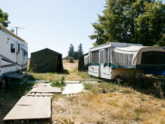 The Tubbses, a family of seven, have been living in trailers in their yard in Jefferson for nearly a year as of Tuesday, July 17, 2018. They moved to the area from California last year to find that the home they had purchased was contaminated with high levels of meth, and must be professionally decontaminated before they can live in it.