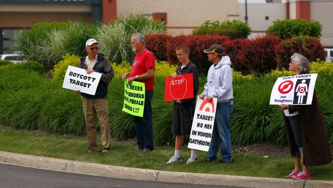 Protesters gathered on Walker Lake Road in Ontario on Saturday to promote a boycott of Target, after the store announced in April that it would allow transgender individuals to go into the bathroom or fitting room of their gender indenity.