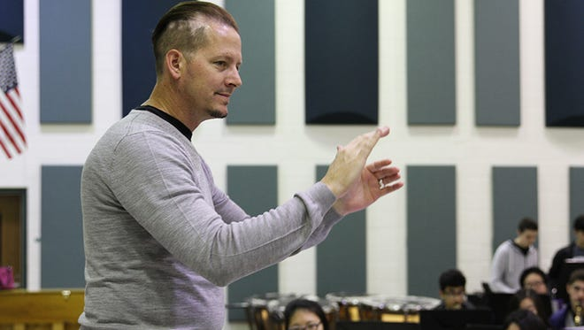 Mark Hourigan, the director of bands at Novi High School since 2002, was named District 4 Band Teacher of the Year by the Michigan School Band and Orchestra Association.