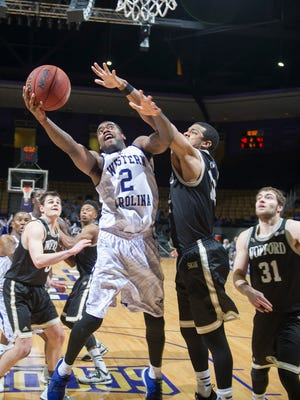 Western Carolina's Mike Brown goes around Wofford defender for two points.