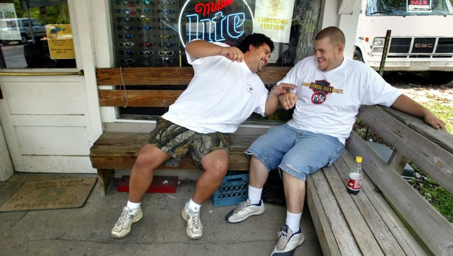 Former Halfway Market owner Ted Traffanstedt and his brother Benji Reed,  joke around on the porch of the store in this 2003 photo.  -(Photo by Jeanne Reisel/Staff)