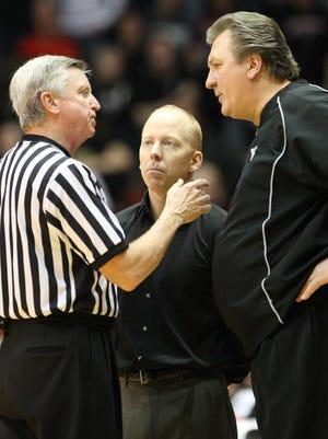 Cincinnati head coach Mick Cronin and West Virginia head coach Bob Huggins discuss a call with an official in January of 2010.