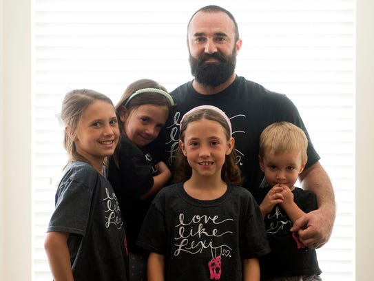 Tanner Rice and his children, from left, Avery, Elena,
