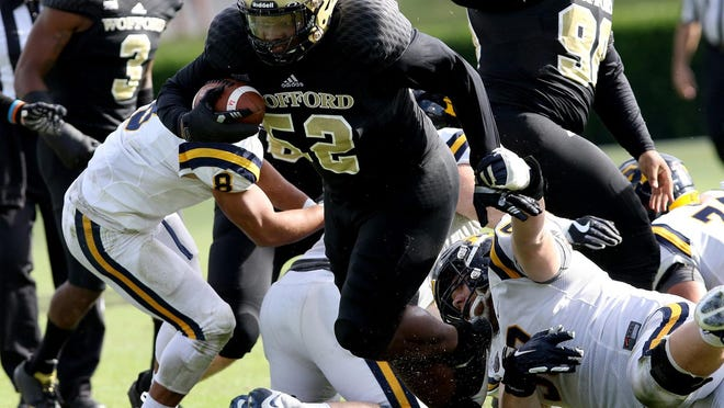 Wofford's Thad Mangum in a rare chance to run with the football after he scooped up a fumble during a 2018 game against East Tennessee State. Mangum is being waved on by one of his best friends, Terriers all-time great Miles Brown.
