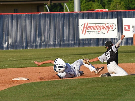 North DeSoto's Carson Curtis gets around the tag at