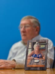 Eugene Leonard of Falls Church, Va, is shown with a photo of his wife Carol during a trip to a Mexican resort in 2016. She died of sepsis after thyroid surgery at MedStar Washington Hospital Center in February 2017.