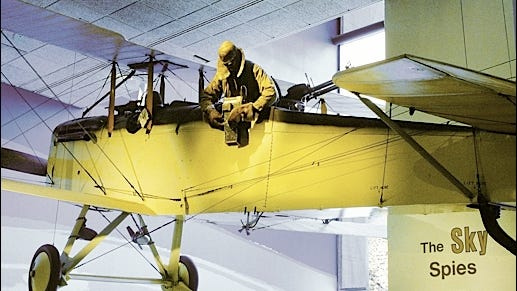 World War I aircraft (De Havilland DH-4) hanging in National Air and Space Museum on the Mall in Washington, D.C.; displaying a pilot and an observer in reconnaissance mode. (Smithsonian photo)