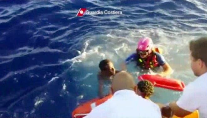 The Italian Coast Guard rescues a survivor of a ship that caught fire and sank off the Sicilian island of Lampedusa, Italy.