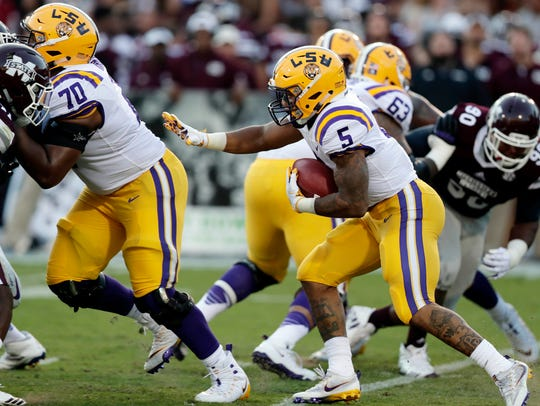 LSU running back Derrius Guice (5) follows his blockers