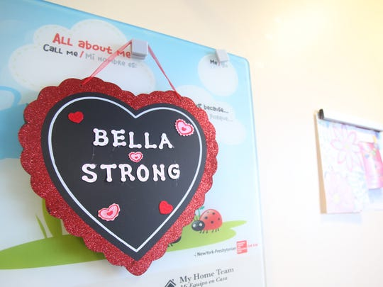 A Bella Strong heart hangs on the wall of Isabella Munoz's room at Morgan Stanley Children's Hospital in Manhattan Jan. 25, 2018. Bella has been in the hospital since Jan. 6th  waiting for an open heart surgery, and the stuff monkey has never left her bedside since being diagnosed with a heart condition two years ago.