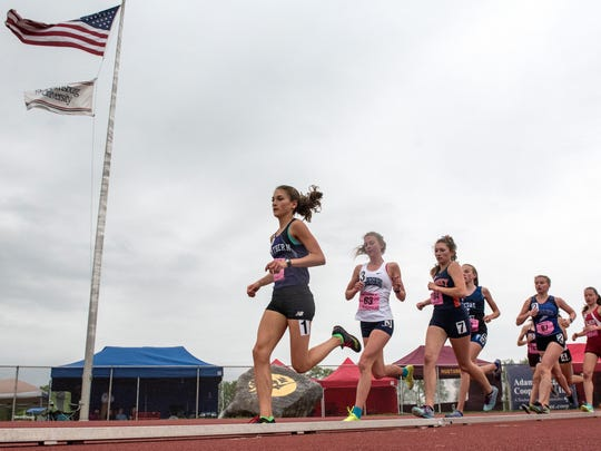 Northern York's Marlee Starliper leads runners during the Class AAA 3200-meter run at the District III track and field championships May 18. Starliper took first place.