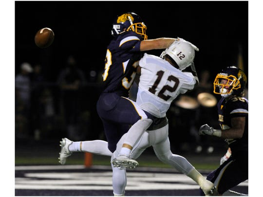 Wylie High School defensive back Brady Horn blocks a pass meant for Brownwood High School wide receiver Adonis McCarty during Friday's game Oct. 13, 2017. Wylie won in overtime, 45-38.