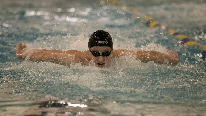 Morristown sophomore Tommy Cromie swims butterfly in the 200-meter medley relay.