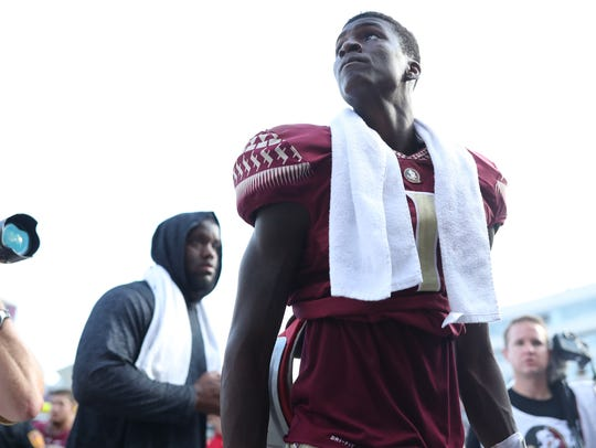 FSU's James Blackman walks off the field after the