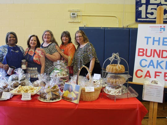Members of the Jewish women's organization Hadassah pose with a bounty of bundt cakes. Shown are Nora Messing, Judi Abrams, Laura Floyd, Robin Brown and Rosalie Nagler.