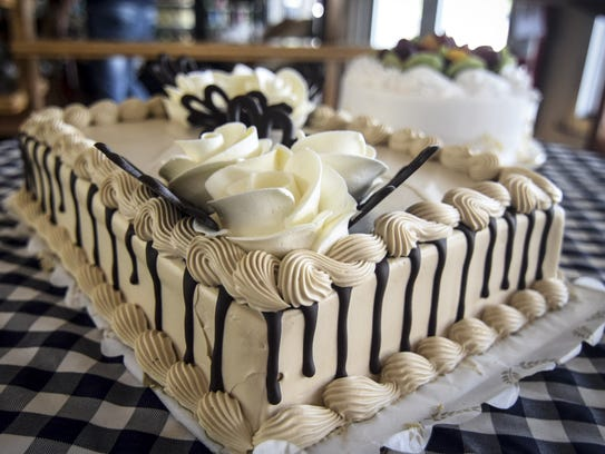 A mocha cake is prepared at Crown Bakery in Barrigada.