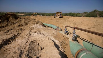 New pipelines that will carry gas from Texas to Mexico are laid underground near General Bravo, in Nuevo Leon state, Mexico.