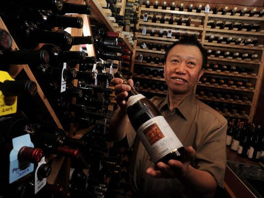 Chef Kuan Lim, owner of Lucky Palace, shows off the wide selection of wine available at the Bossier City restaurant that opened in 1997.