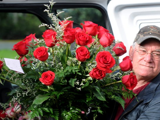 Lenny Benoit delivers roses to a home on Valentine's
