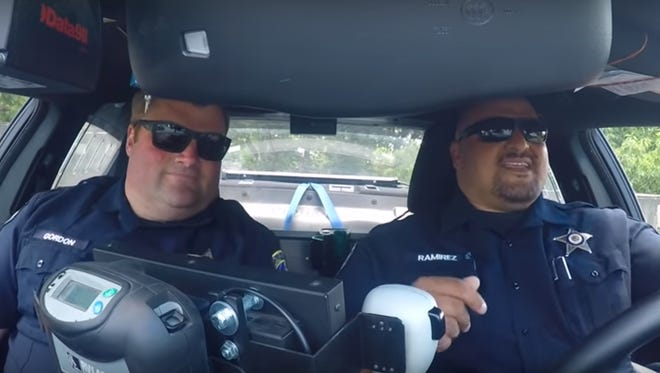 "Salem Police detectives Jeff Gordon and Kevin Ramirez bust out their moves for a rendition of Michael Jackson's ""P.Y.T. (Pretty Young Thing)."""