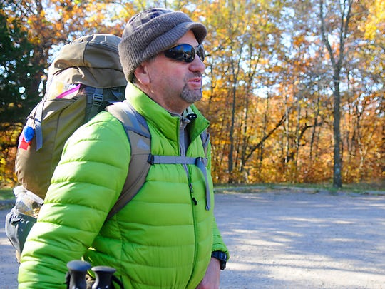 Dan Russell packs up after a weekend at Lake Maria State Park on Saturday. Russell was one of many campers who drove out to Lake Maria to see the peak fall colors.