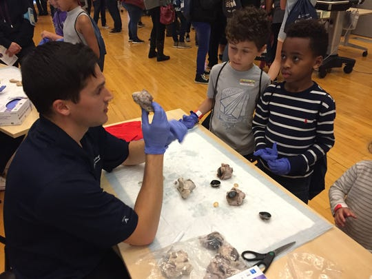 Julian Coulston and Eli Altman, both 6, learn about the inside of a cow's eyeball at a Connect2STEM exhibit in Phoenix on Jan. 27, 2018.