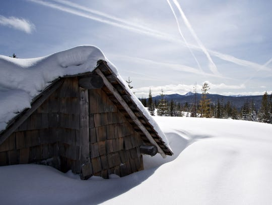 Fuji Mountain shelter covered by snow. Reaching the