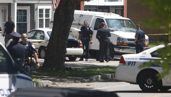 Rochester police, shown investigating the July 22 shooting on Parsells Avenue, made an arrest in connection with the case on Aug. 10, 2015.