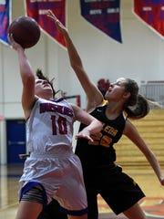 Galena's Zoe Conatser attempts a block on Reno's Jill Rovetti during Thursday's game at Reno.