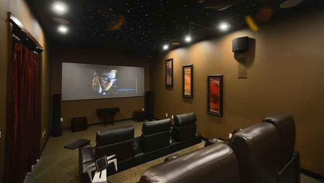 The home theater room at Audio Video Extremes is decked out with a 138-inch projection screen, leather theater seating, earth-shaking high-end audio, and even stars in the ceiling on Wednesday, Oct. 19 in Waite Park.