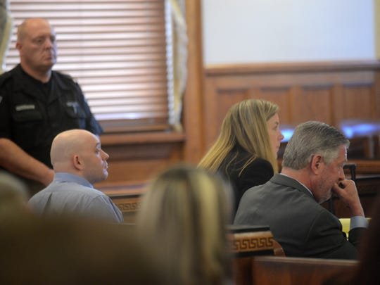 Kenneth Stahli, left, sits with his attorneys, Ulster County Assistant Public Defender MariAnn Connolly and Public Defender Andrew Kossover, Thursday.