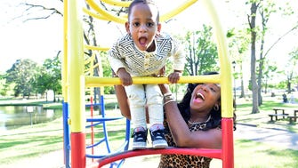 Karter Flanigan and his mother, Kisha Flanigan, play on the monkey bars at Strawberry Patch Park in Madison. Born three months shy of his due date with lungs that were not developed, Karter is now a healthy 2-year-old.