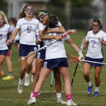 Janie Cowley (22) of Manasquan hugs Maggie Fabean after she scored a goal against Wall Twp. during SCT girls lacrosse game at Sea Girt Army Camp, Seagirt,NJ. Wednesday, May 11, 2016. Noah K. Murray-Correspondent/Asbury Park Press