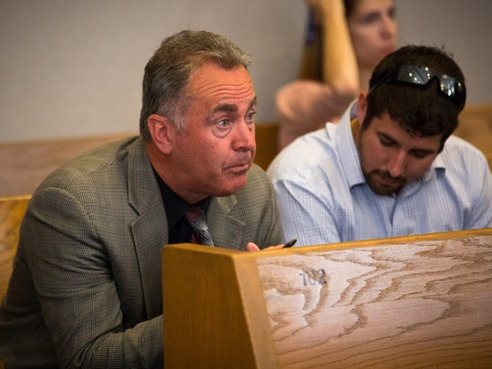 Doña Ana County District Attorney Mark D'Antonio, left,
