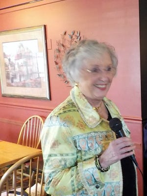 Pictured is Carol Torresani, speaking after receiving her 50-year award.